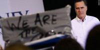 Romney heckled by Occupy protesters before New Hampshire primary, fights back
