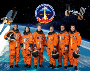 The STS-133 crew portrait. Pictured are NASA astronauts Steve Lindsey (center right) and Eric Boe (center left), commander and pilot, respectively; along with astronauts (from the left) Alvin Drew, Nicole Stott, Michael Barratt and Steve Bowen, all mission specialists.