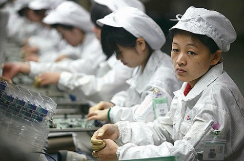 Foxconn workers making Apple products in China, where over a dozen employees committed suicide.