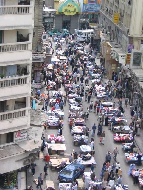 A diplomatic van hits protesters on the streets of Cairo January 28.