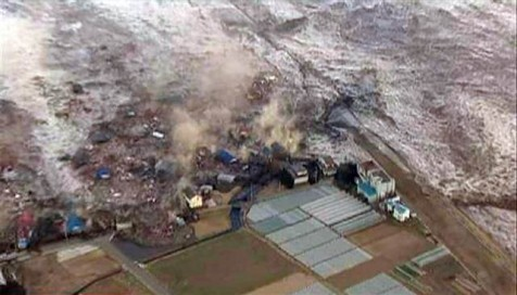 A tsunami wave obliterates everything in its path in Japan.