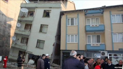 A building collapses under its foundation from the 6.0 magnitude earthquake in Simav.  Turkish authorities blame shoddy construction on many of the deaths caused by earthquakes in the region. (Photo from Reuters)