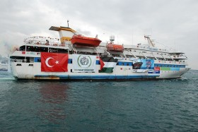 A firefight broke out on the Turkish aid ship Mavi Marmara after activists bound for the Gaza strip violently resisted a boarding by the Israeli navy in response to the aid ship breaking the Israel blockade of Gaza.