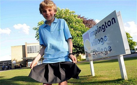 12 year old Impington Village College pupil Chris Whitehead wears a skirt in protest at his school's policy of making boys wear long trousers in the summer <em>Photo: SWNS</em>