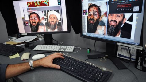 A member of the Agence France Presse photo lab takes a hard look at an image on the internet of what is described as an of Osama bin Laden's dead face.  The picture is a fake and is showing up in virus attachments.