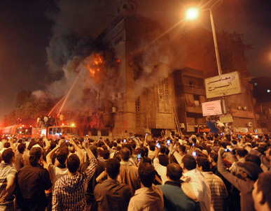 People in the street upload photos of the violence to the internet. Twitter and other internet technologies helped to spread news of the revolutions in the Cairo and the middle east.