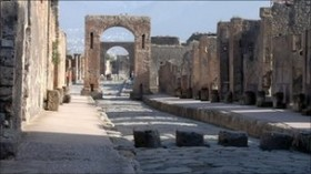 A street in the ruins of Pompeii that is similar to the city of Herculaneum where the scientists discovered the large deposit of human feces.