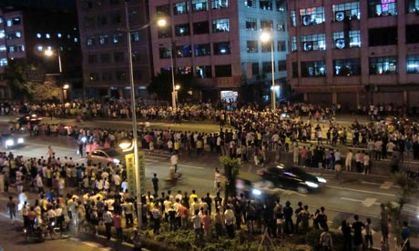 Police struggle to regain control as the riot enters its third night.  Police fire tear gas into the crowd as protesters throw bricks and bottles at police.