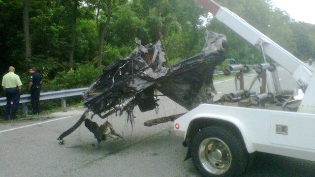 The mangled remains of what is believed to be Ryan Dunn's Porsche being taken away by a tow truck. (Thanks to JALOPNIK.com for the picture)