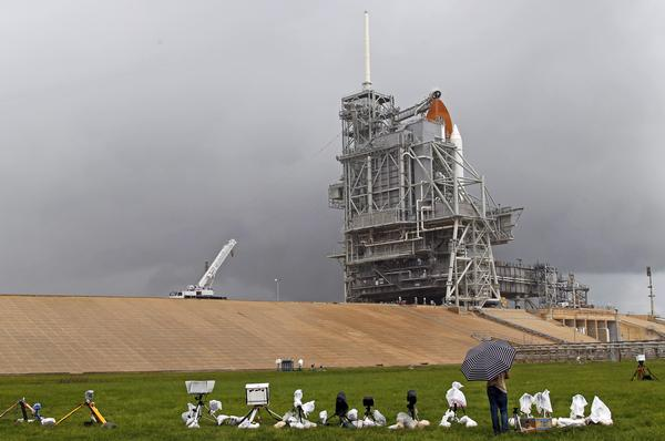 The space shuttle Atlantis lifts off from the Kennedy Space Center Thursday, July 7, 2011, in Cape Canaveral, Fla. Atlantis is the 135th and final space shuttle launch for NASA. (AP Photo/Terry Renna)