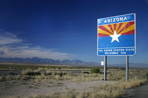 A sign welcoming visitors from New Mexico into Arizona.  Photo by Wing-Chi Poon