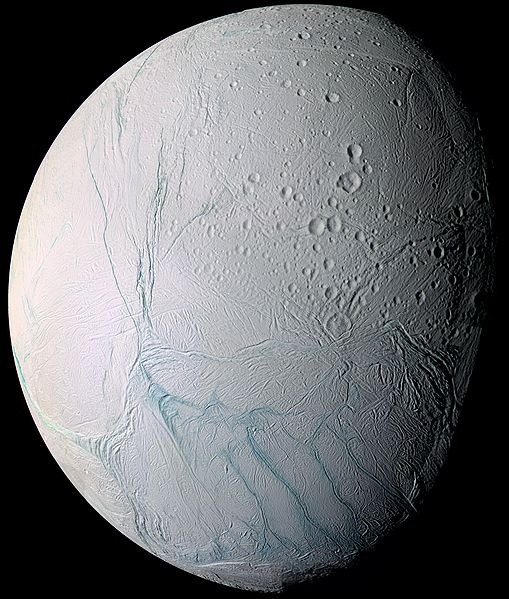 The surface of Enceladus is ice covered and cracked from tidal heating from Saturn.