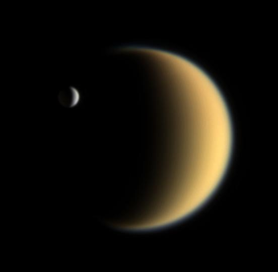 LIfe on other worlds? Enceladus is seen hovering in front of Saturn's largest moon Titan.