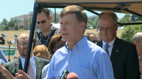 John Hickenlooper, Mayor of Aurora speaking at a press conference.