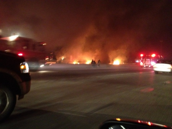 Flames can be seen engulfing the road.