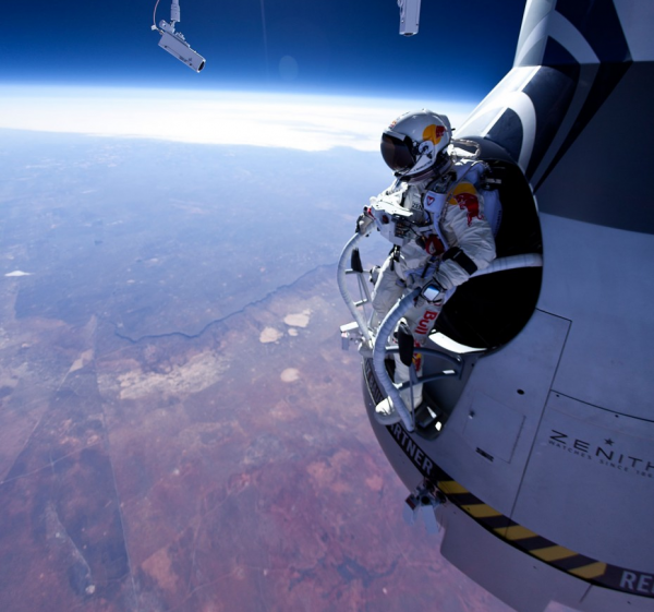 Felix Baumgartner, stepping into the void from 71,580 feet during a test jump in March. The Austrian adventurer plans a record-setting jump from 120,000 feet on Tuesday. Photo: Jay Nemeth/Red Bull Content Pool
