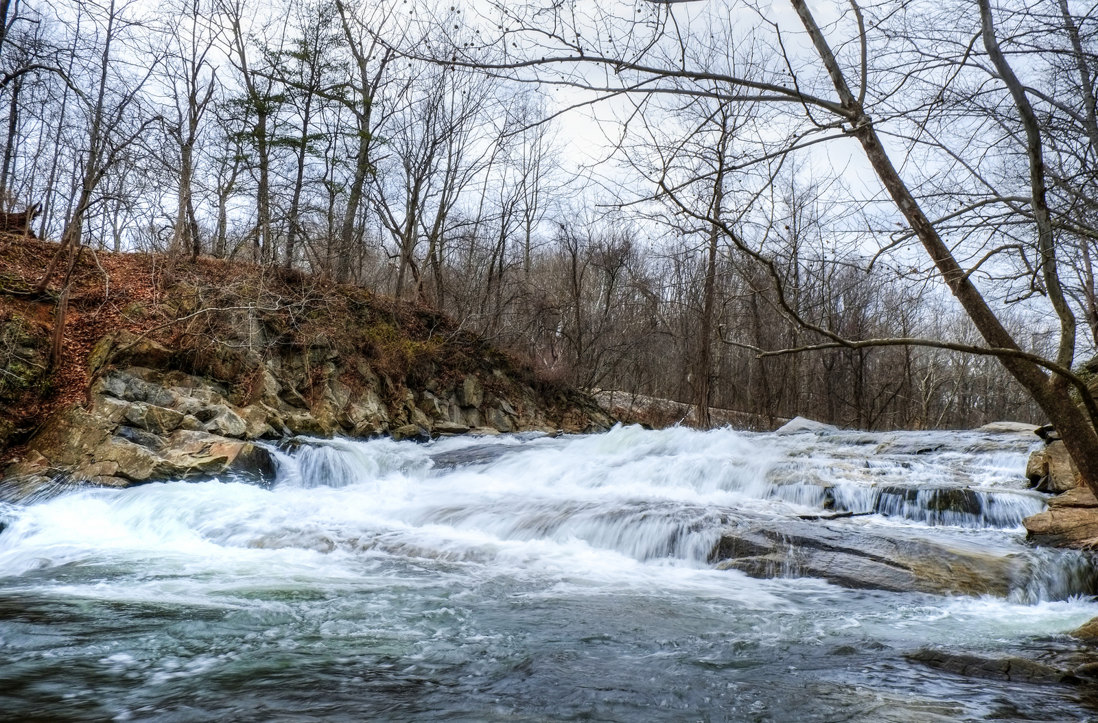 The rapids from the lower branch of the Patapsco River comes barreling over some rocks by the train tracks near the start of the hike.  Photo by Daniel Hart.