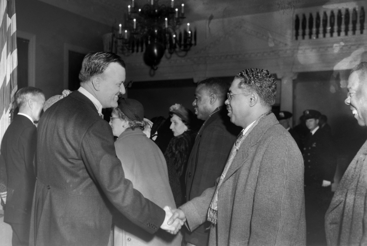 Governor Theodore McKeldin shaking hands with Martin Jenkins, President of Morgan State College. Paul Henderson, 1951. MdHS, HEN.00.B1-067.