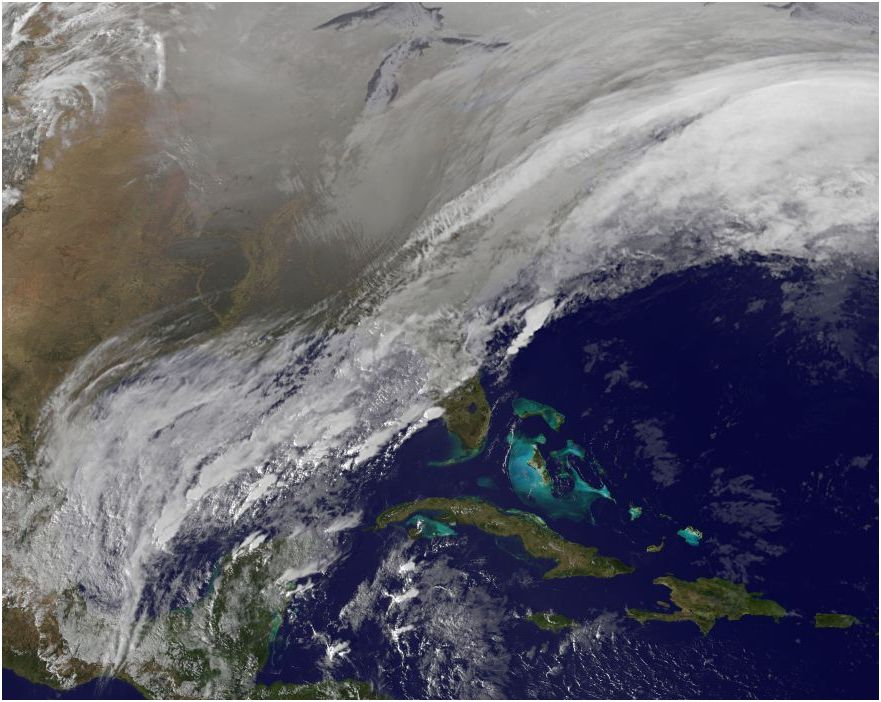 NOAA satellite image showing snow from Winter Storm Hercules blanketing most of nation.