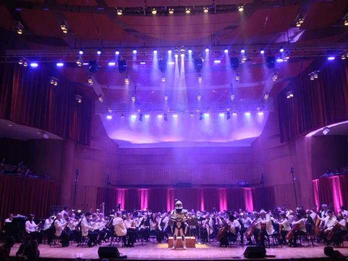 """Look sir, musicians"". The Baltimore Symphony Orchestra is guarded by an audience member dressed as a stormtrooper. (Credit: NEXTGEN FM NEWS)"