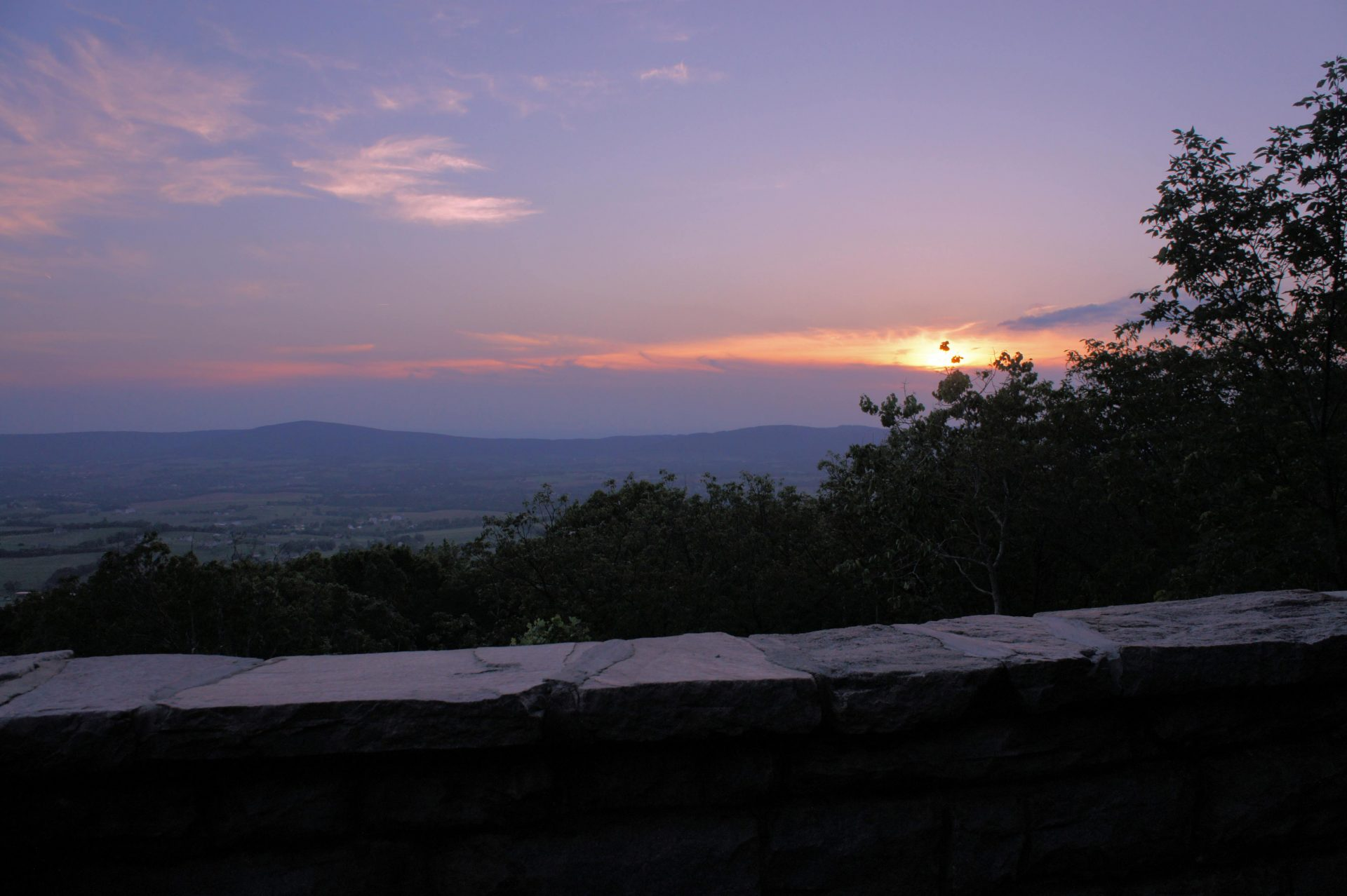 The sun setting over Middletown below at Gambrill State Park